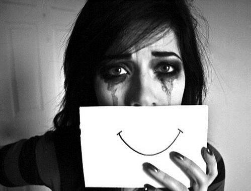 mulher_depressao_sorriso_choro